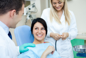 Dentist,_DA,_and_Patient_smiling